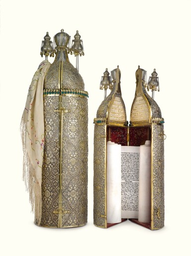 View 1. Thumbnail of Lot 38. A RARE SET OF CHINESE EXPORT PARCEL-GILT SILVER-CASED TORAH SCROLL AND HAFTARAH SCROLL, THE SCROLLS SENT BY THE BEN ISH HAI TO FLORA SASSOON, THE CASES MARKED GOTHIC K, PROBABLY 1893.