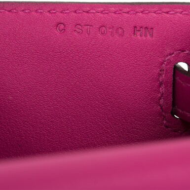 View 9. Thumbnail of Lot 15. Hermès Rose Pourpre Swift Mini Kelly Pochette.