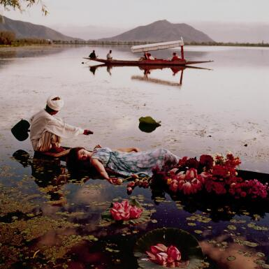 NORMAN PARKINSON   'FLOATING WITH FLOWERS', DAL LAKE, KASHMIR II, INDIA, VOGUE, 1956