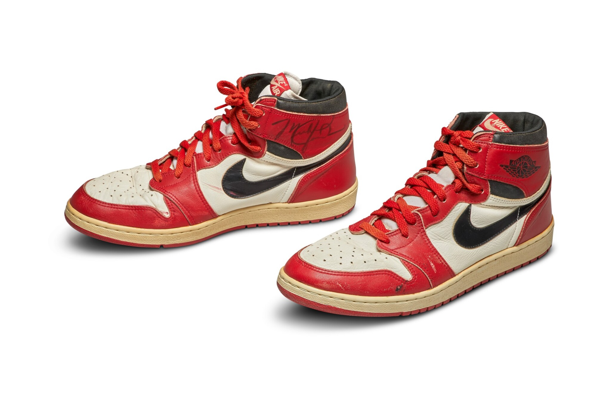 View 1 of Lot 1. Michael Jordan's Game Worn 1985 Player Sample Air Jordan 1s | Sizes 13, 13.5.