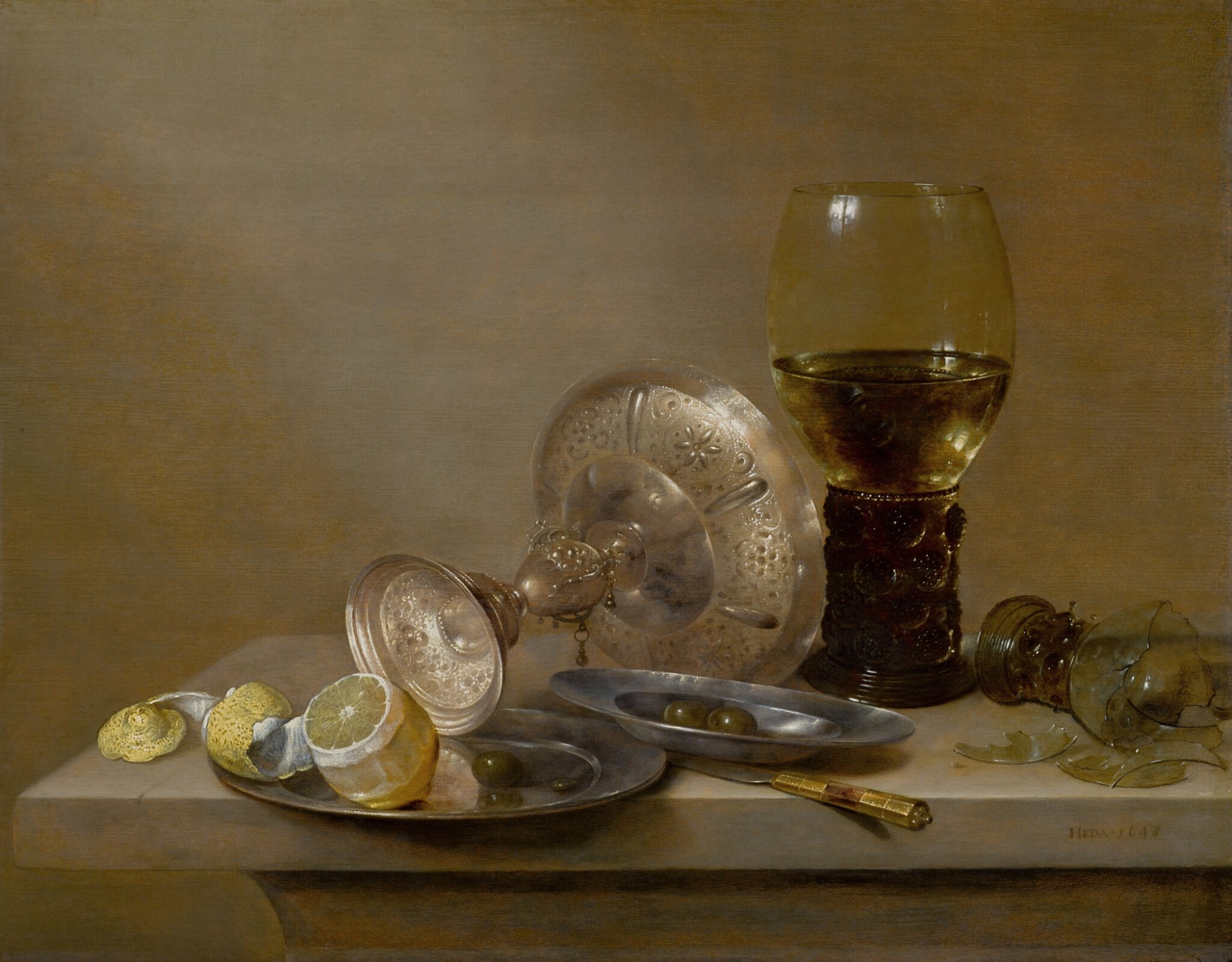 View full screen - View 1 of Lot 24. A vanitas still life with a broken roemer, an upturned tazza and a peeled lemon, all on a ledge   《虛空派靜物畫:石架上的破酒杯、倒轉的扁花瓶與去皮檸檬》.