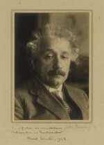 [EINSTEIN, ALBERT] | BLACK & WHITE PHOTOGRAPHIC PORTRAIT OF EINSTEIN, SIGNED & INSCRIBED BY EINSTEIN ON MAT