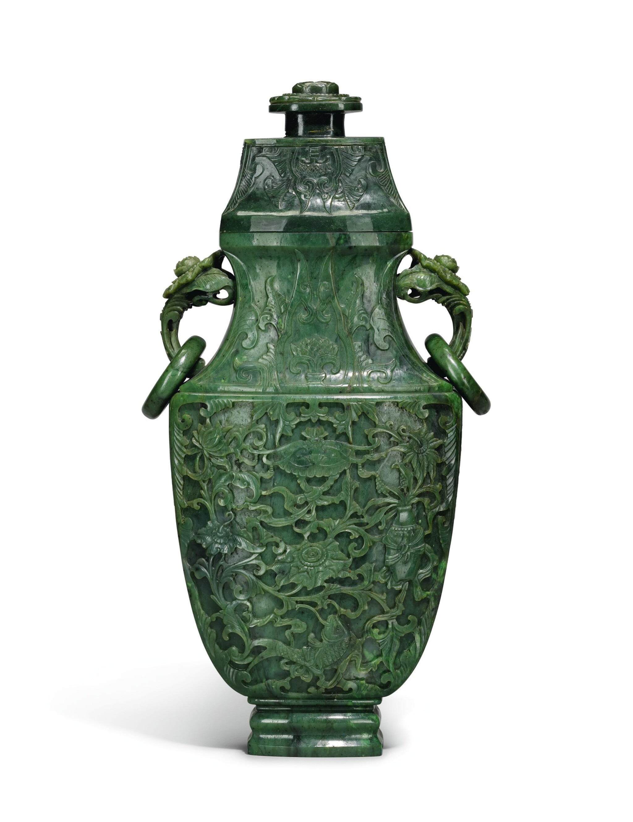 View full screen - View 1 of Lot 222. A large spinach jade vase and cover, Qing Dynasty, Qianlong period   清乾隆 碧玉番蓮八吉祥紋活環耳蓋瓶.