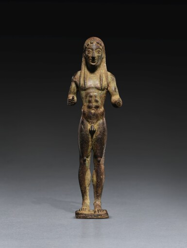 A GREEK BRONZE FIGURE OF A KOUROS DEDICATED TO APOLLO, LACONIAN, MID 6TH CENTURY B.C.