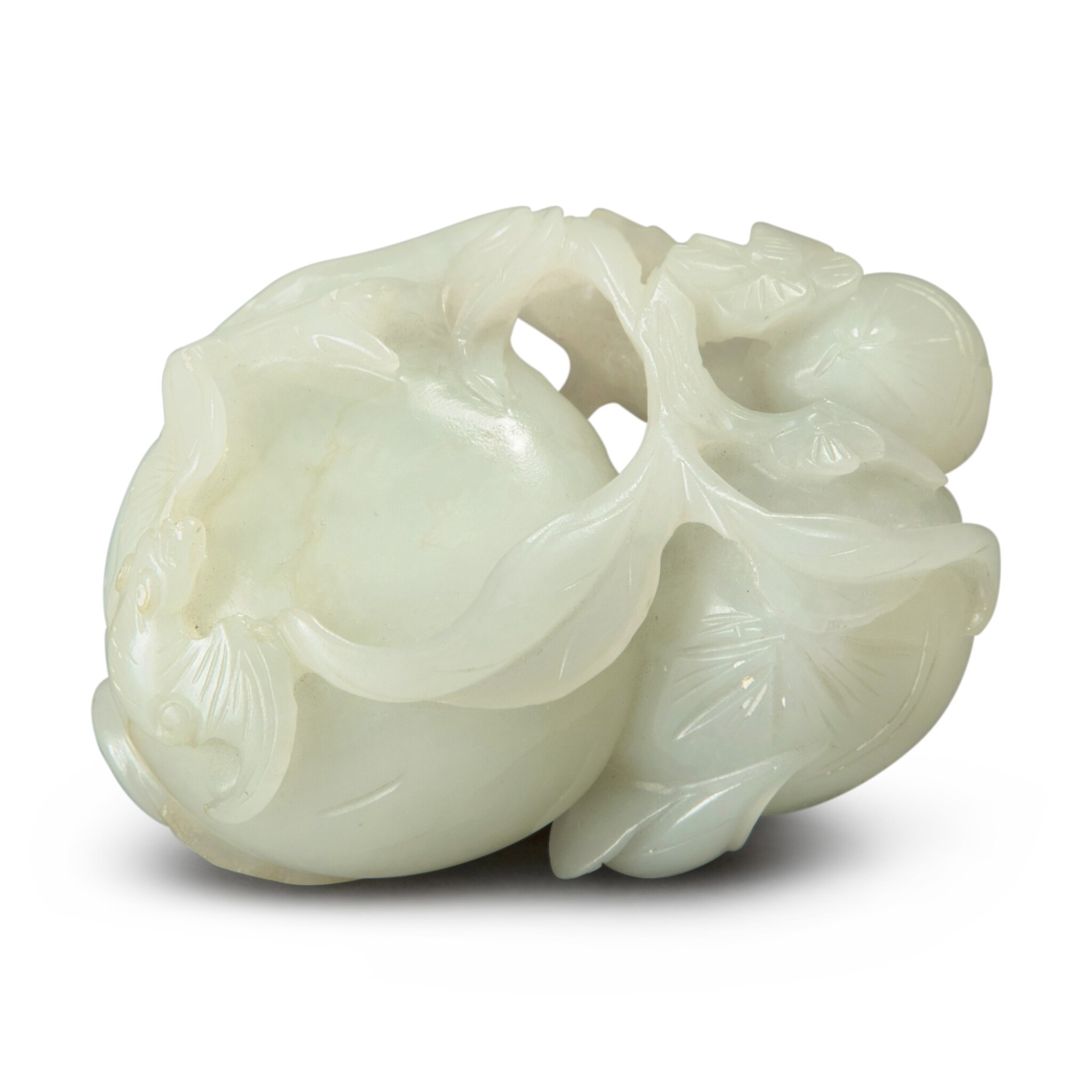 View full screen - View 1 of Lot 88. A white jade 'bat, peach, water chestnut and prunus' group, Qing dynasty, 18th / 19th century.