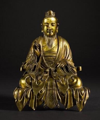 A RARE GILT-BRONZE SEATED FIGURE OF A DAOIST DEITY QING DYNASTY, 18TH CENTURY | 清十八世紀 鎏金銅道教神仙坐像