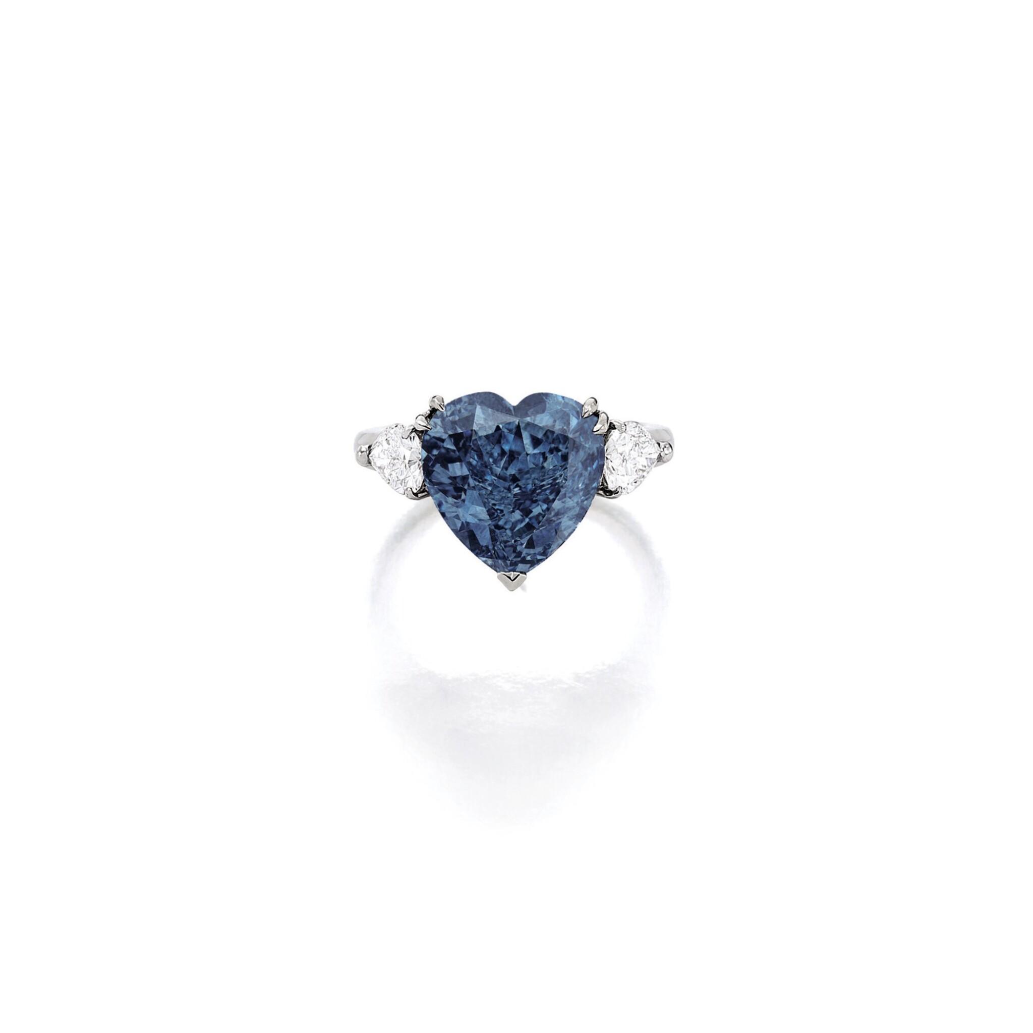 View full screen - View 1 of Lot 1806. A SUPERB FANCY VIVID BLUE DIAMOND AND DIAMOND RING  5.04卡拉 心形 艷彩藍色 VS2淨度 鑽石 配 鑽石 戒指.