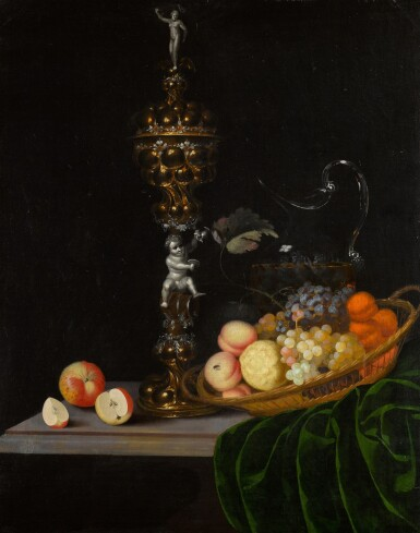 View 1. Thumbnail of Lot 138. Still life with an elaborate silver gilt standing cup, a basket of fruit, and a glass wine jug upon a partly draped table.