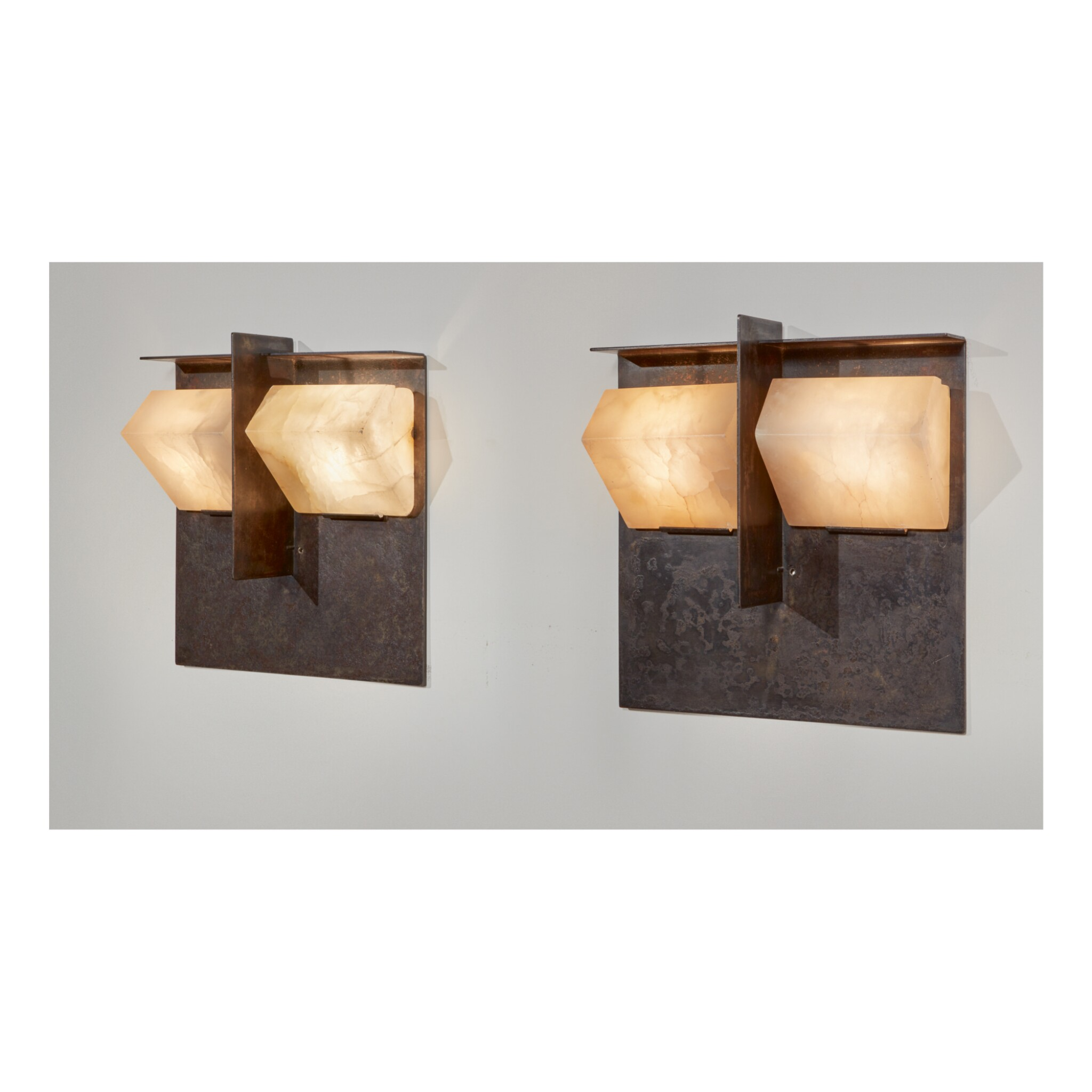"PIERRE CHAREAU | PAIR OF ""MASK"" SCONCES, MODEL NO. LA551"
