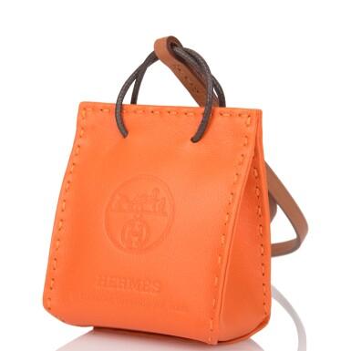 View 3. Thumbnail of Lot 100. Hermès Orange Bag Charm.