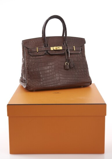 View 1. Thumbnail of Lot 20. Matte havanne niloticus crocodile, canvas and gold plated hardware handbag, Birkin 35, Hermès, 2002.