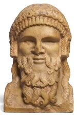 ROMAN GIALLO ANTICO MARBLE HERM BUST OF DIONYSOS OR HERMES, CIRCA 2ND CENTURY A.D.