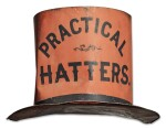 ORANGE AND BLACK PAINTED TIN MILLINER'S TRADE SIGN, LATE 19TH CENTURY