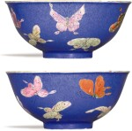 A PAIR OF POWDER-BLUE GROUND FAMILLE-ROSE 'BUTTERFLY' BOWLS JIAQING SEAL MARKS AND PERIOD | 清嘉慶 藍地粉彩百蝶紋盌一對 《大清嘉慶年製》款
