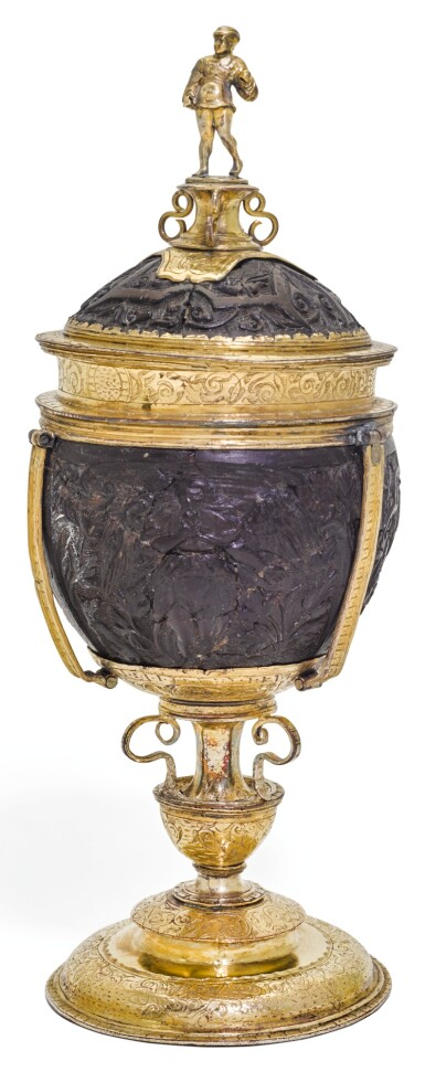 A GERMAN GILT-COPPER MOUNTED COCONUT CUP AND COVER, POSSIBLY NUREMBERG, CIRCA 1550