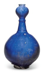 AN INTACT KASHAN BLUE-GLAZED BOTTLE VASE, PERSIA, 12TH/13TH CENTURY