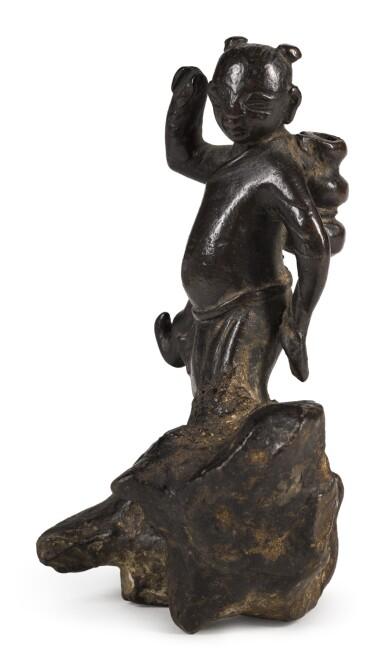 A BRONZE FIGURE OF A BOY DANCING ON A ROCK   17TH/18TH CENTURY   十七/十八世紀 銅童子擺件