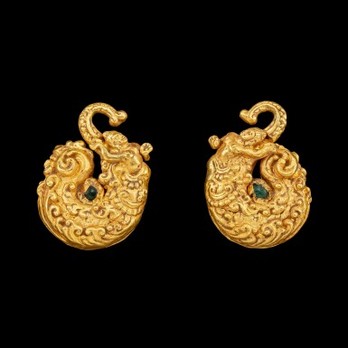 View 1. Thumbnail of Lot 1025. A pair of gold repoussé 'Makara and human figure' earrings set with green glass beads Pre-Khmer, 8th century | 八世紀 前高棉時期 摩羯神像紋金耳飾一對.