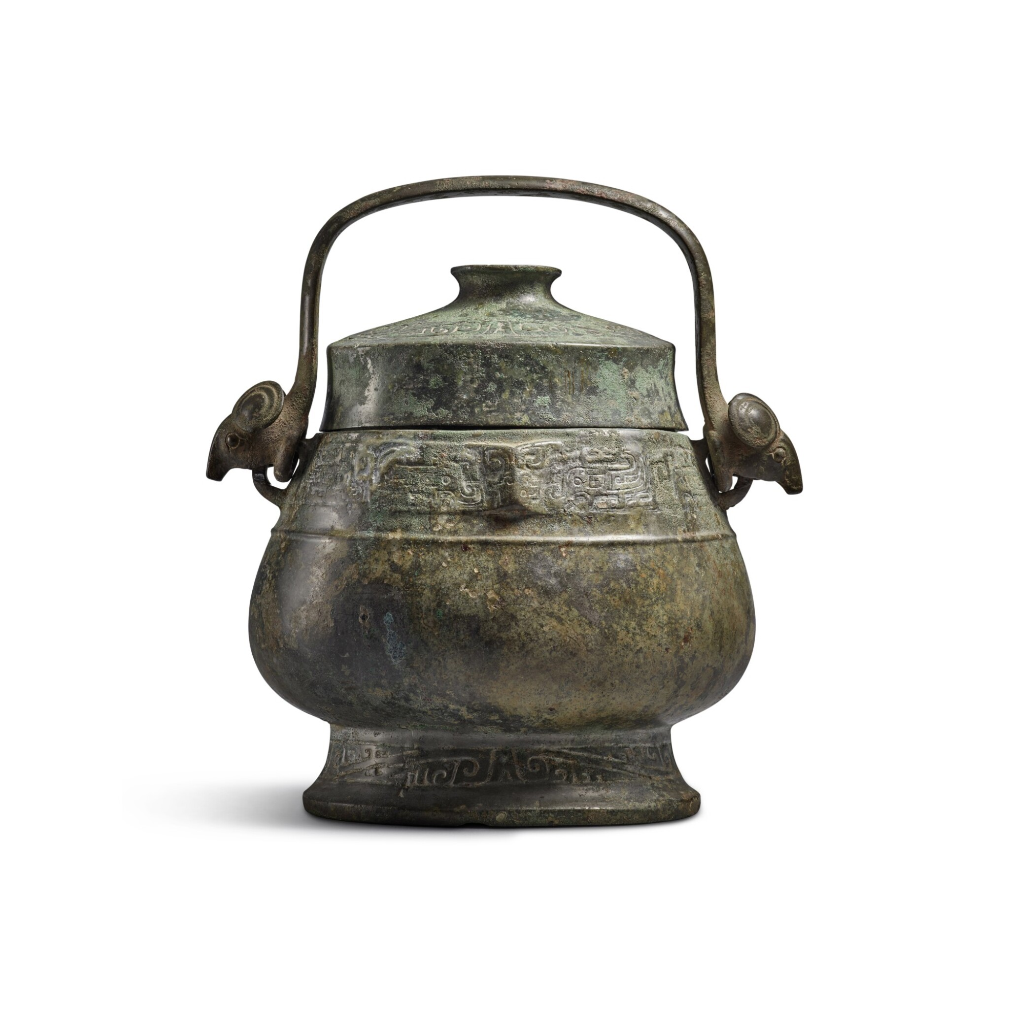 View full screen - View 1 of Lot 6. An archaic bronze ritual wine vessel and cover (You), Western Zhou dynasty | 西周 青銅龍紋卣.
