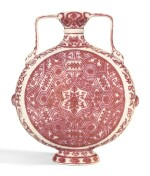 A RARE MING-STYLE COPPER-RED DECORATED MOONFLASK QIANLONG SEAL MARK AND PERIOD   清乾隆 釉裏紅蓮花錦紋如意耳抱月瓶 《大清乾隆年製》款