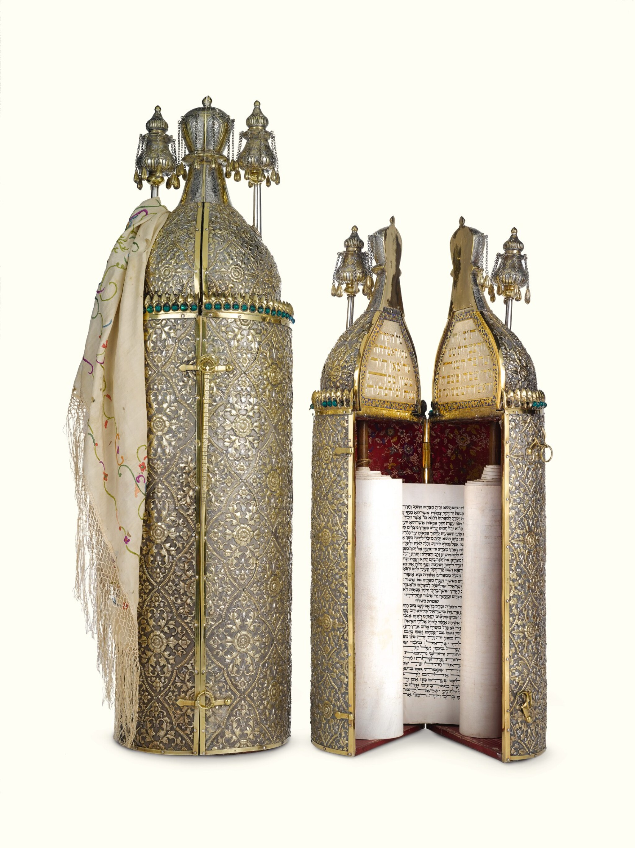 View full screen - View 1 of Lot 38. A RARE SET OF CHINESE EXPORT PARCEL-GILT SILVER-CASED TORAH SCROLL AND HAFTARAH SCROLL, THE SCROLLS SENT BY THE BEN ISH HAI TO FLORA SASSOON, THE CASES MARKED GOTHIC K, PROBABLY 1893.