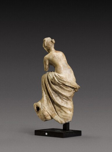 View 3. Thumbnail of Lot 71. A Roman Marble Fountain Figure of a Nymph, circa 1st Century A.D..