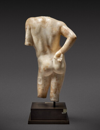 View 5. Thumbnail of Lot 27. A Roman Marble Torso of Narcissus, circa 1st Century A.D..