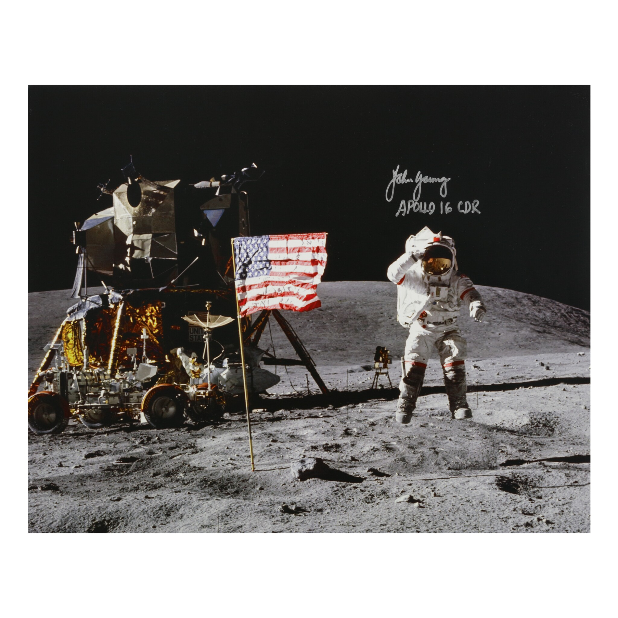 View full screen - View 1 of Lot 205. [APOLLO 16]. JOHN YOUNG JUMPING SALUTE. COLOR PHOTOGRAPH, SIGNED AND INSCRIBED BY JOHN YOUNG.