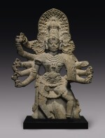 A GRANITE FIGURE OF A DEITY POSSIBLY VIRABHADRA SOUTH INDIA, 16TH/17TH CENTURY