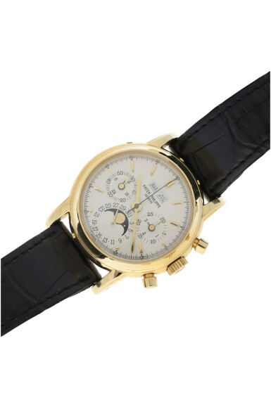 View 4. Thumbnail of Lot 30. PATEK PHILIPPE | REFERENCE 3970E  A YELLOW GOLD PERPETUAL CALENDAR CHRONOGRAPH WRISTWATCH WITH MOON PHASES AND LEAP YEAR INDICATION, MADE IN 1992.
