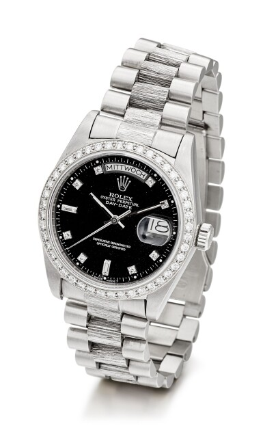 View 2. Thumbnail of Lot 1107. ROLEX | DAY-DATE, REFERENCE 1803, A WHITE GOLD AND DIAMOND-SET WRISTWATCH WITH DAY, DATE, BRACELET AND LATER RODIUM-PLATED BEZEL, CIRCA 1982.