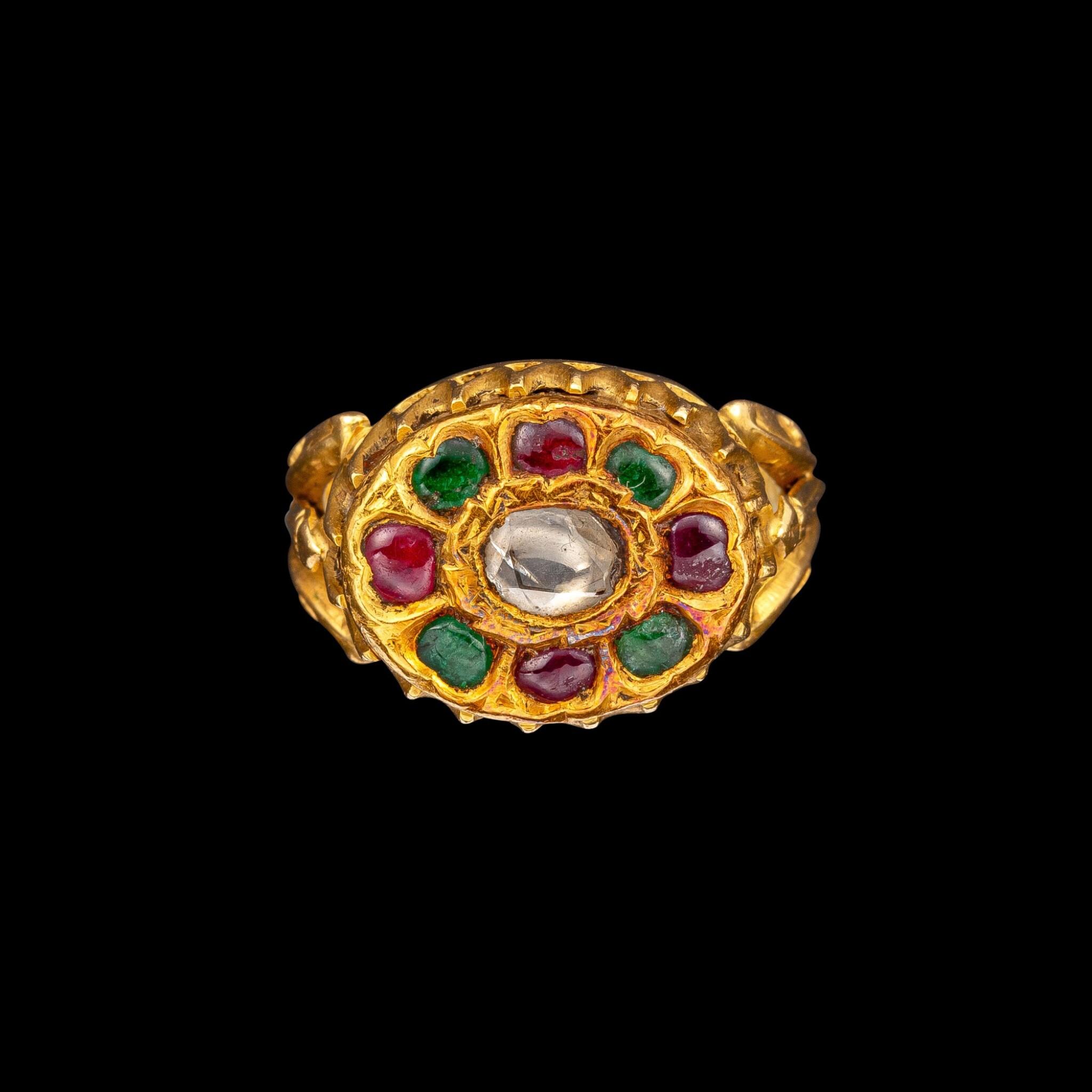 View full screen - View 1 of Lot 1081. A gold, diamond, ruby and emerald 'floral' ring South India, 19th century | 十九世紀 南印度 金嵌鑽石、紅寶石及祖母綠花形戒指.