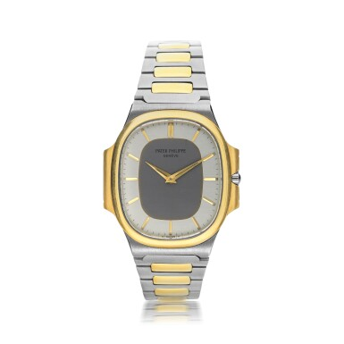 View 1. Thumbnail of Lot 134. PATEK PHILIPPE      REFERENCE 3770 'NAUTELLIPSE' A YELLOW GOLD AND STAINLESS STEEL OVAL FORM BRACELET WATCH, CIRCA 1982.