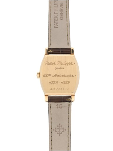 View 4. Thumbnail of Lot 168. PATEK PHILIPPE   REFERENCE 3969  A LIMITED EDITION TONNEAU SHAPED PINK GOLD JUMP HOUR WRISTWATCH, MADE TO COMMEMORATE THE 150TH ANNIVERSARY OF PATEK PHILIPPE, MADE IN 1989.