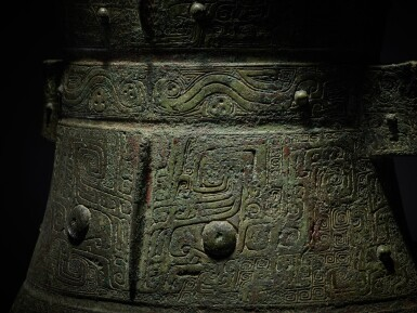 View 11. Thumbnail of Lot 8. A magnificent and rare archaic bronze ritual wine vessel (Hu), Late Shang dynasty   商末 青銅饕餮紋壺.