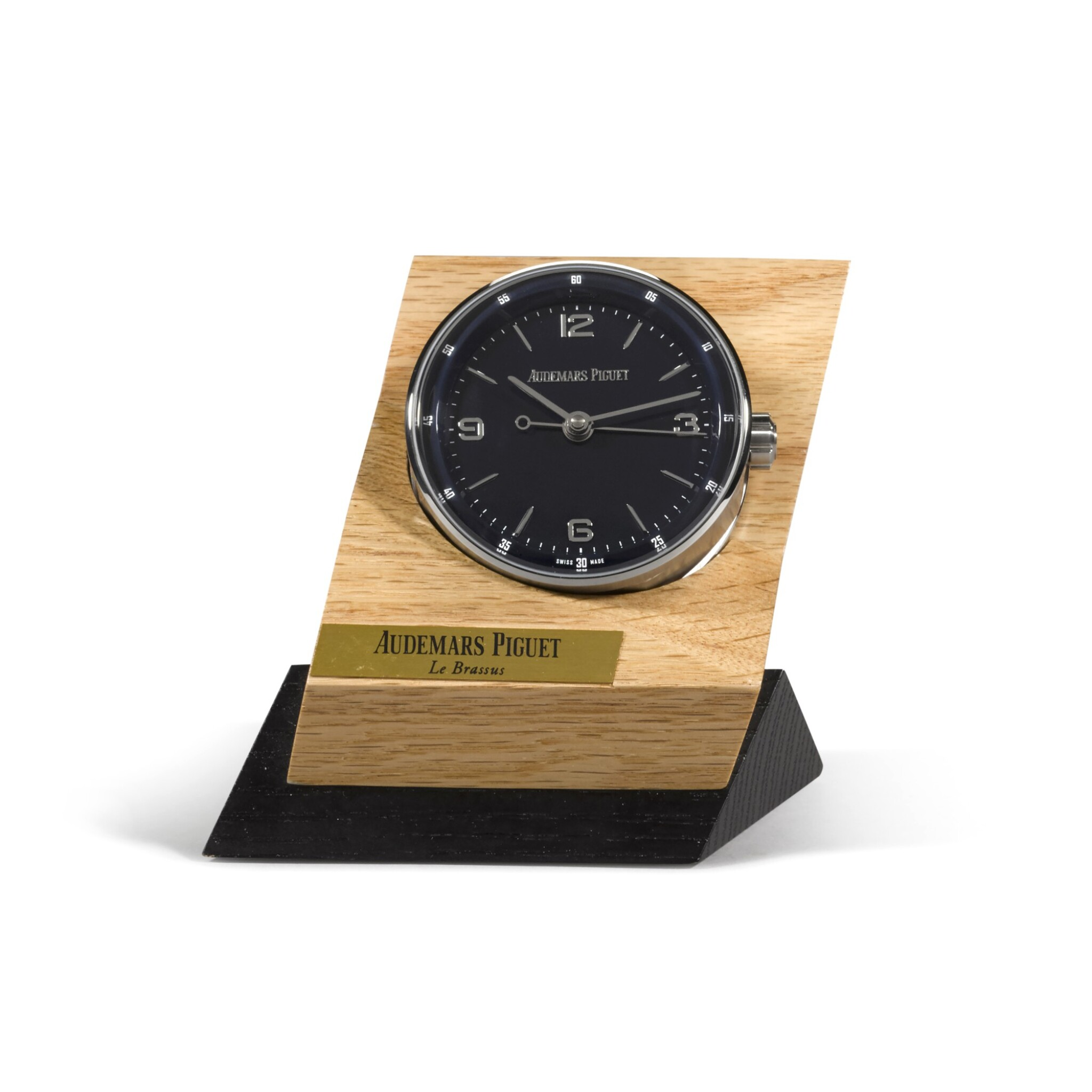 View full screen - View 1 of Lot 724. STAINLESS STEEL DESK TIMEPIECE WITH ALARM AND WOODEN STAND CIRCA 2015.
