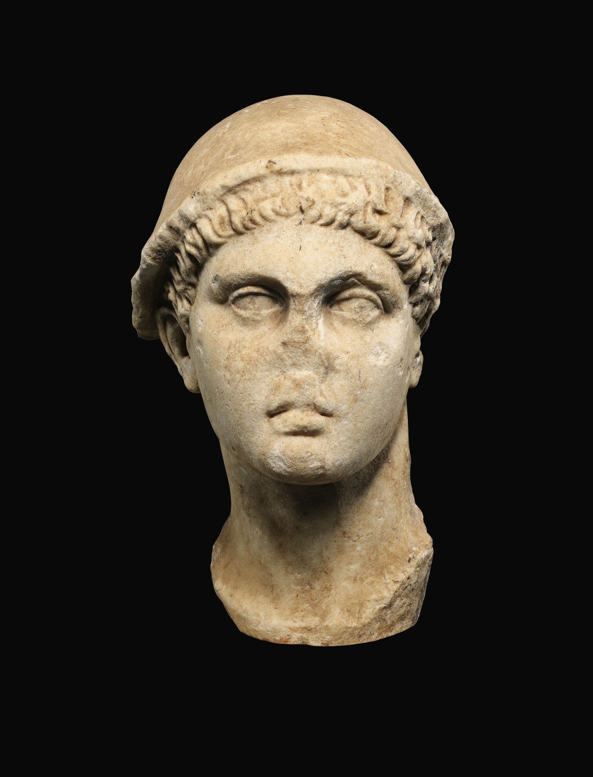 View full screen - View 1 of Lot 24. A ROMAN MARBLE HEAD OF HERMES, CIRCA 1ST CENTURY A.D..