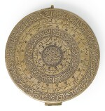 A SAFAVID ENGRAVED QIBLA-INDICATOR WITH COMPASS AND MARKINGS TO MECCA AND MEDINA, SIGNED BY MUHAMMAD KHALIL IBN HASAN 'ALI, PERSIA, DATED 1080 AH/1669 A
