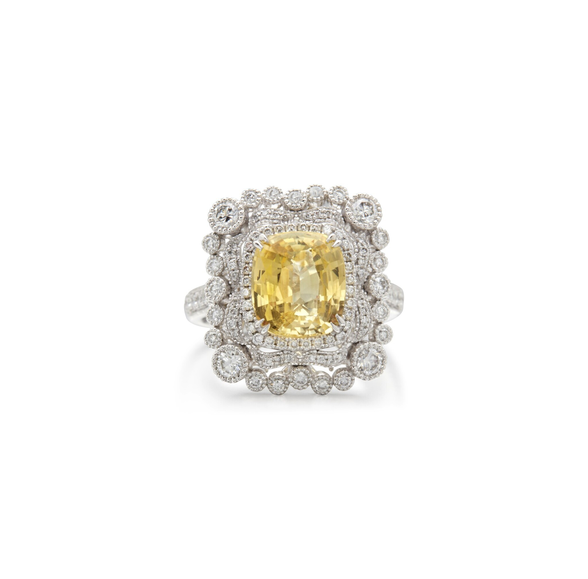View full screen - View 1 of Lot 13. YELLOW SAPPHIRE AND DIAMOND RING.