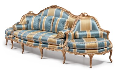View 3. Thumbnail of Lot 64. A Louis XV Carved Giltwood Canapé à Confidents, Mid-18th Century.