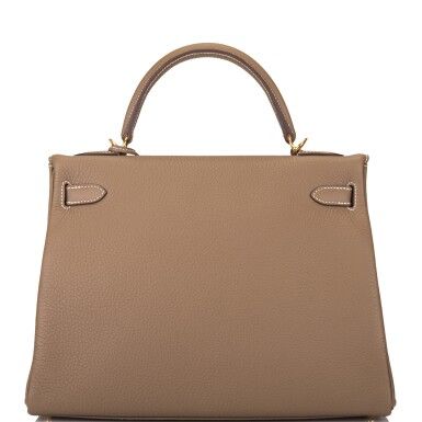 View 4. Thumbnail of Lot 70. HERMÈS | ETOUPE RETOURNE KELLY 32CM OF TAURILLON CLEMENCE LEATHER WITH GOLD HARDWARE.