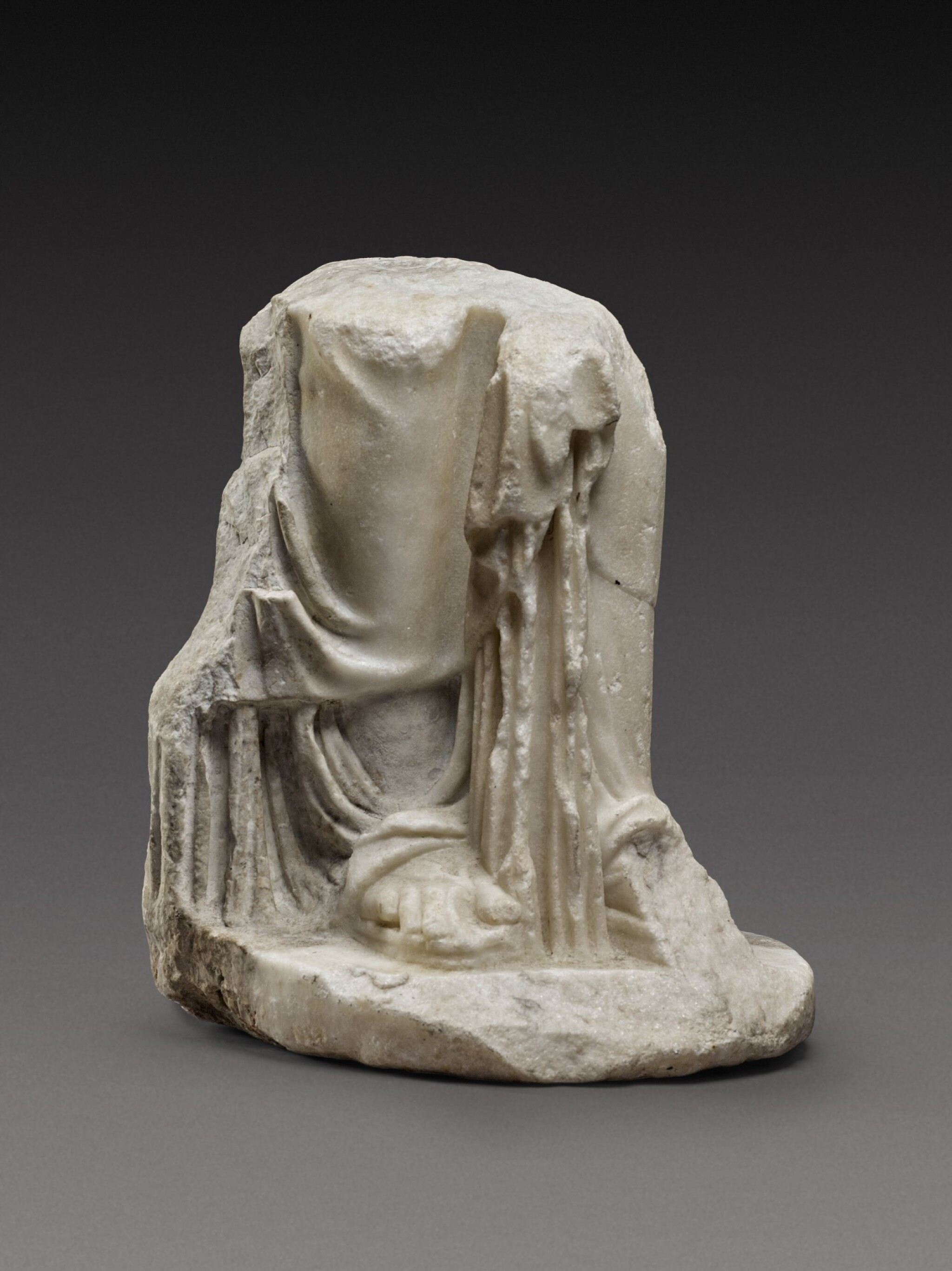 View full screen - View 1 of Lot 88. A Fragmentary Roman Marble Figure of a Woman or Goddess, circa 2nd Century A.D..