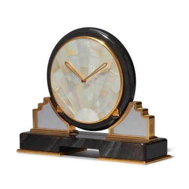 View 2. Thumbnail of Lot 56. AN OBSIDIAN, MOTHER OF PEARL, ROCK CRYSTAL AND GILT BRASS DESK TIMEPIECE, CIRCA 1980.