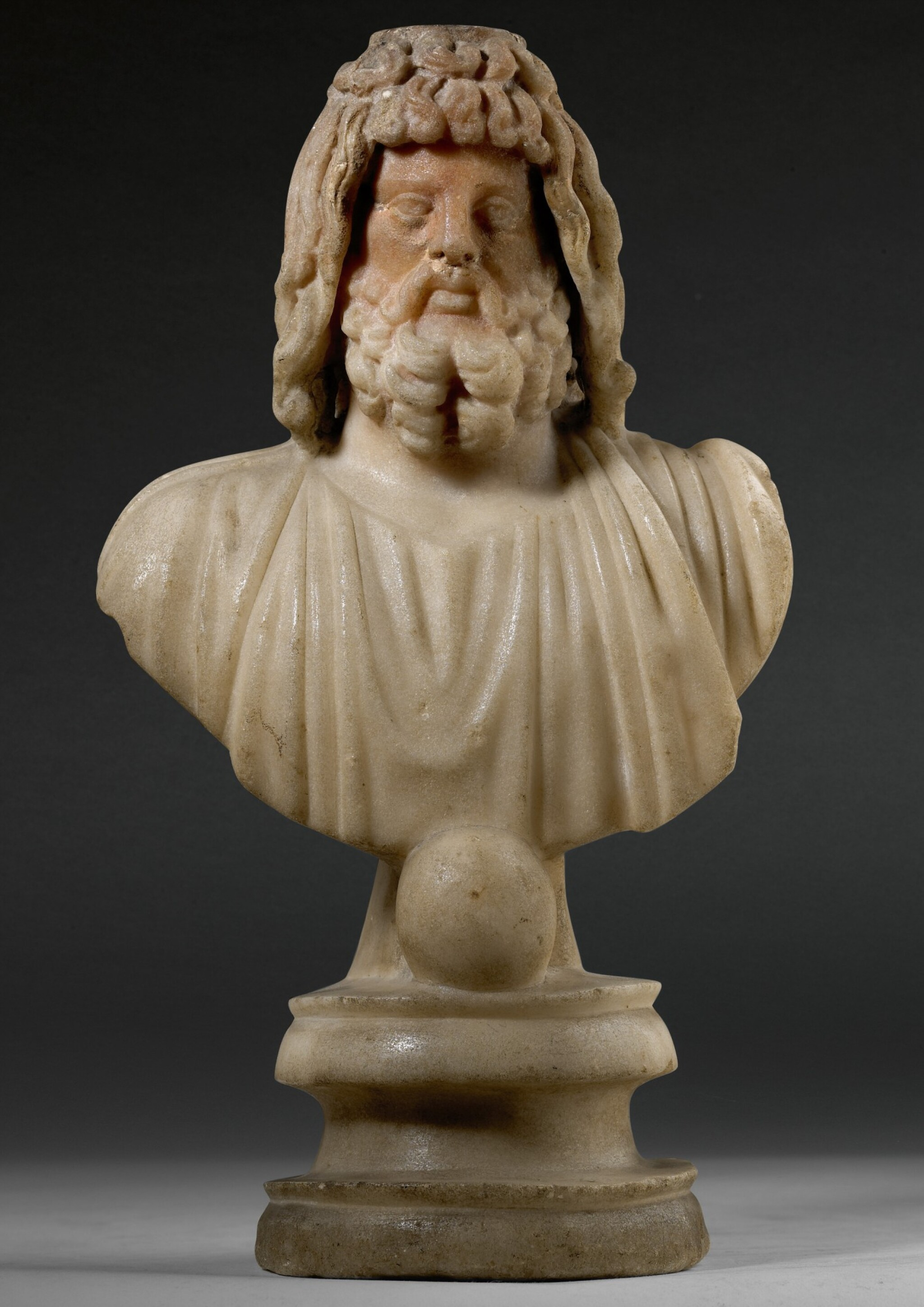 View full screen - View 1 of Lot 31. A ROMAN MARBLE BUST OF SARAPIS, CIRCA 2ND CENTURY A.D..