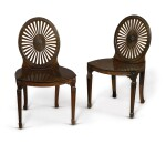 A SET OF FOUR GEORGE III MAHOGANY WHEEL-BACK HALL CHAIRS, LATE 18TH CENTURY