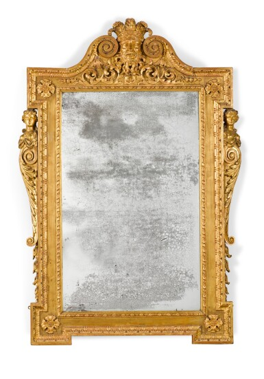 View 1. Thumbnail of Lot 57. A GEORGE II CARVED GILTWOOD MIRROR, CIRCA 1735.