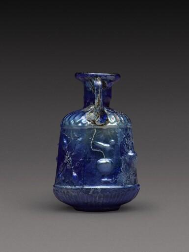 View 4. Thumbnail of Lot 3. A Roman Cobalt Blue Mould-Blown Glass Amphoriskos, circa 1st century A.D..