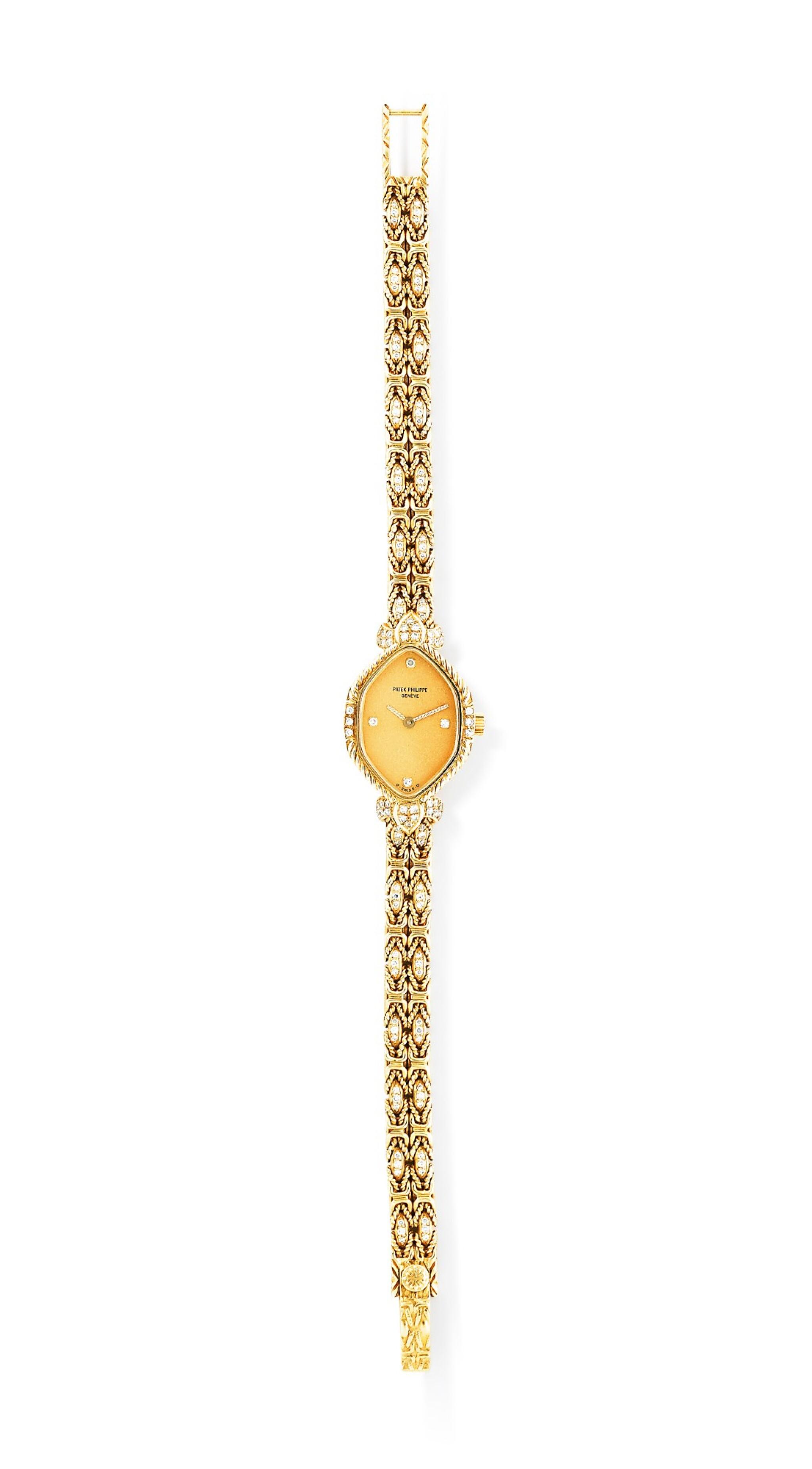 View full screen - View 1 of Lot 121. Patek Philippe | Montre bracelet de dame or et diamants | Lady's gold and diamond bracelet watch.