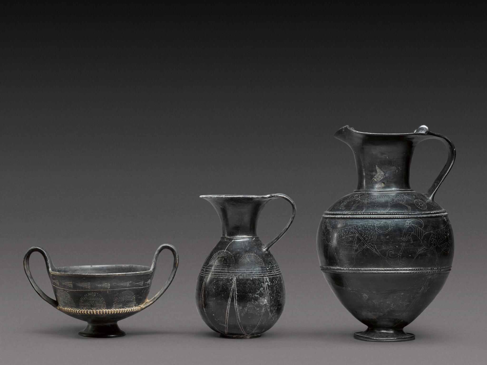 View full screen - View 1 of Lot 37. Three Etruscan Bucchero-Ware Vessels, 7th/6th Century B.C..