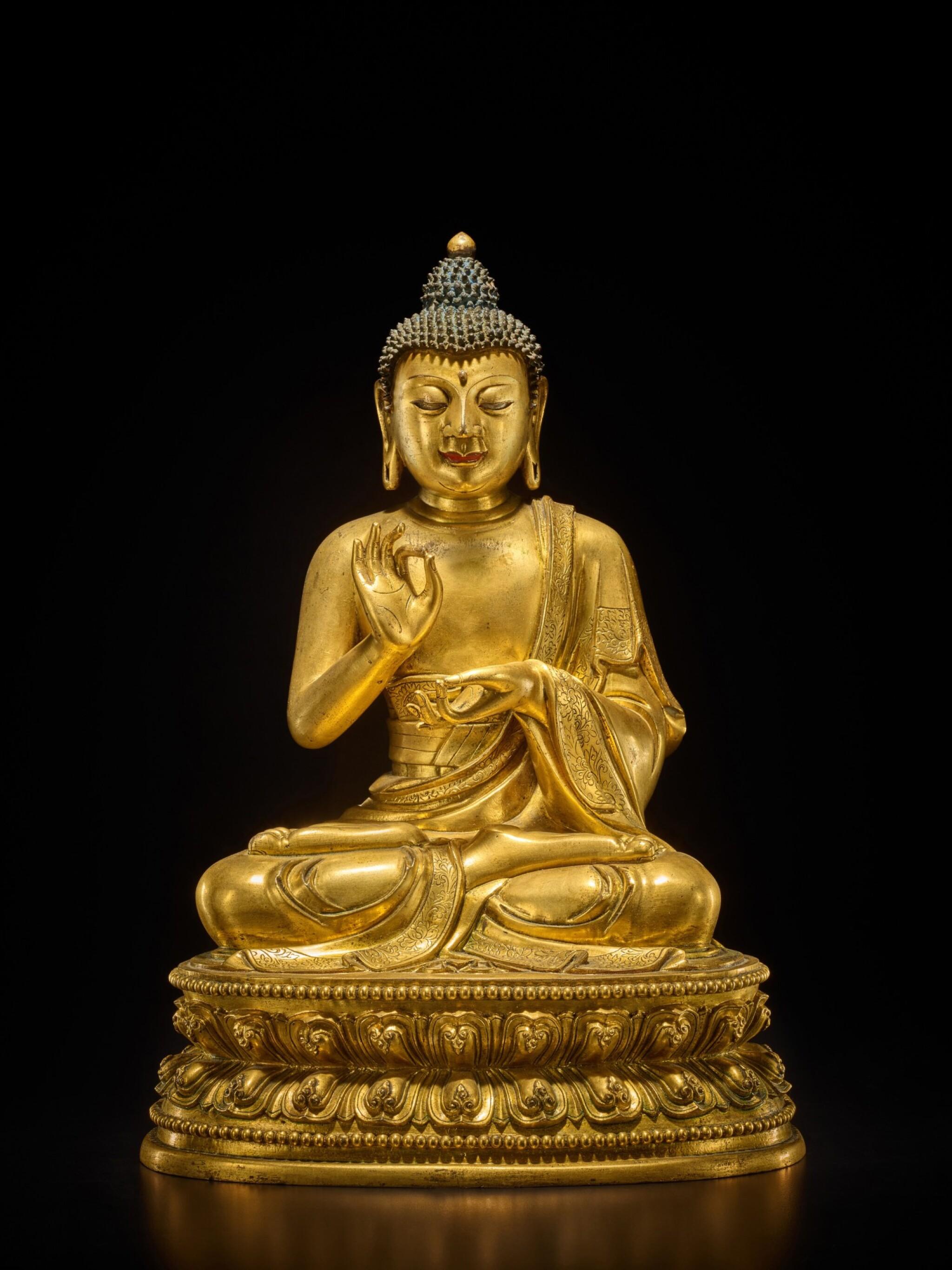 View full screen - View 1 of Lot 60. A large gilt-bronze figure of Dipankara Buddha, Qing dynasty, Kangxi period | 清康熙 銅鎏金燃燈佛坐像.